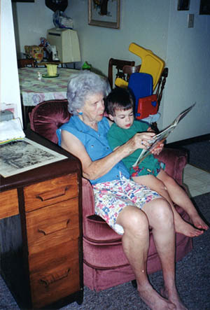 Grandparent with grandson reading
