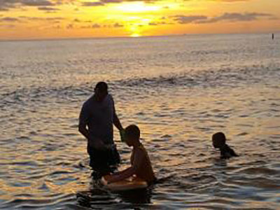Family at lake with sunset